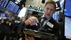 Wall Street cierra lunes en terreno mixto y el Dow Jones retrocede un 0.32%