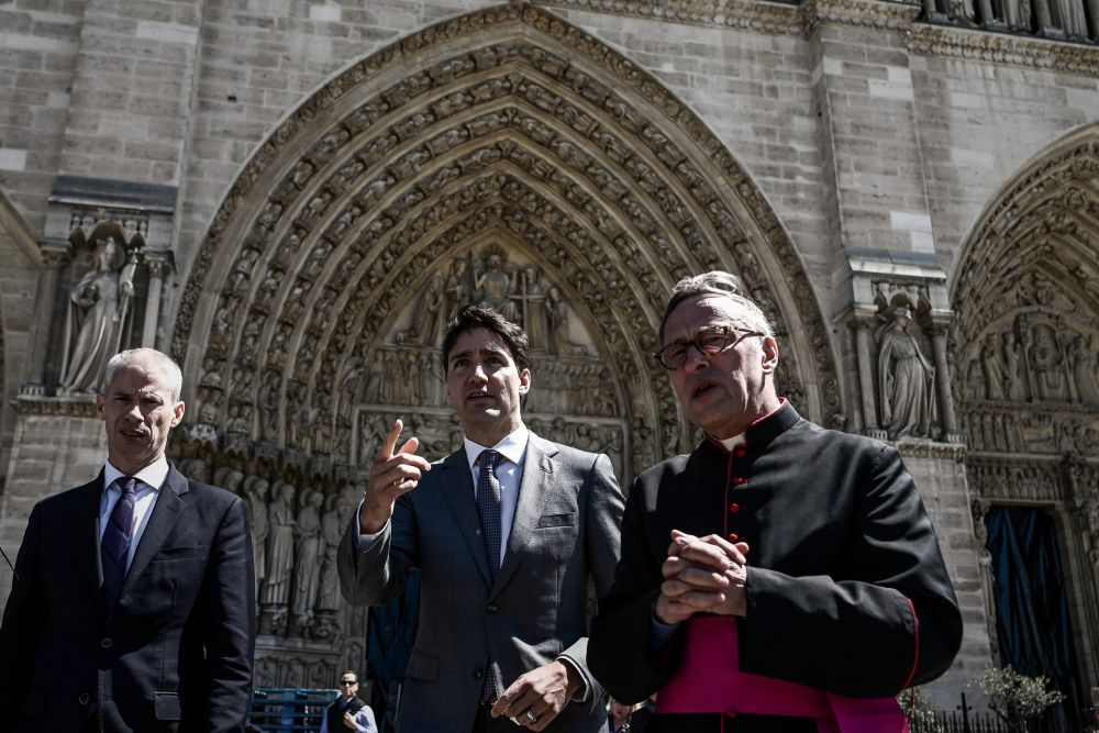 French Culture Minister Franck Riester, Canadian Prime Minsite Justin Trudeau and Notre Dame cathedral rector Patrick Chauvet